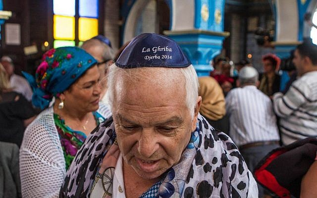 A French Jew, Bebert Zouili, attends the annual Jewish pilgrimage in the resort of Djerba, Tunisia, in the Ghriba synagogue, the oldest Jewish monument built in Africa more than 2,500 years ago, Friday April 26, 2013. (photo credit: AP Photo/Aimen Zine)
