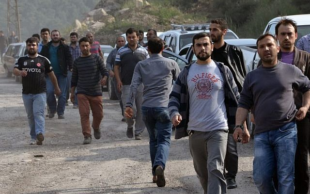 Workers and relatives arrive after an explosion and fire at a coal mine in Soma, in western Turkey, Tuesday, May 13, 2014.  (Photo credit: AP/IHA)