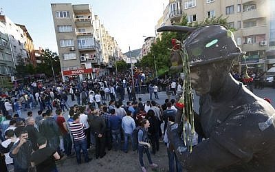 Anti-government protesters rally near the monument for the town's miners in Soma, Turkey where the mine accident took place, Friday, May 16, 2014. Hundreds of protesters took part in the march against the government and there were clashes with the police forces. An explosion and fire at a coal mine in Soma, some 250 kilometers (155 miles) south of Istanbul, killed hundreds of workers, authorities said, in one of the worst mining disasters in Turkish history. (photo credit: AP/Lefteris Pitarakis)