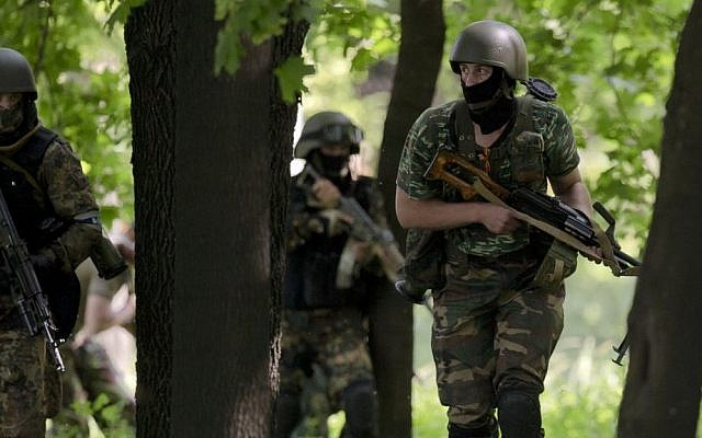 Pro-Russian gunmen take positions near the airport, outside Donetsk, Ukraine, on Monday, May 26, 2014. (photo credit: AP Photo/Vadim Ghirda)