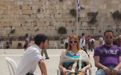 Shalom Shore and two of his street meditation participants at the Western Wall (photo credit: Courtesy Shalom Shore)