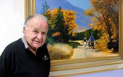 This June 2012 photo shows former 'Mad' magazine editor Al Feldstein standing near one of his paintings at Livingston HealthCare. Feldstein, whose 28 years at the helm of Mad magazine transformed the satirical publication into a pop culture institution, has died, Tuesday, April 29, 2014. He was 88. (photo credit: AP/Livingston Enterprise, Aaric Bryan)