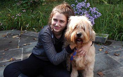 Annie Blumenfeld posing with Teddy, her furry inspiration. (Courtesy Annie Blumenfeld/JTA)