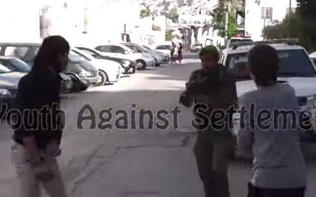 A scene from the encounter in Hebron, uploaded to YouTube by the 'Youth Against Settlements' organization. (photo credit: screen capture YouTube)