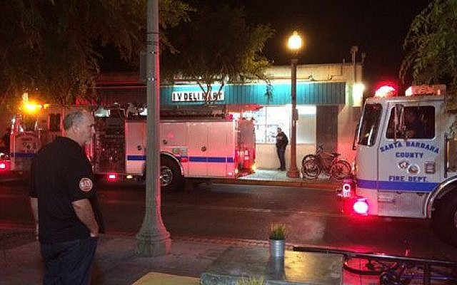 Fire trucks are parked outside the IV Deli Mart on Pardell Road in Isla Vista, Calif., Friday, May 23, 2014, after a drive-by shooter went on a rampage near a Santa Barbara university campus that left seven people dead, including the attacker, and seven others wounded (photo credit: APThe Daily Nexus, Daniel Slovinsky)