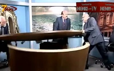 Two Jordanian journalists tear up a TV studio during an argument over Syria's civil war (Photo credit: Youtube screen capture)