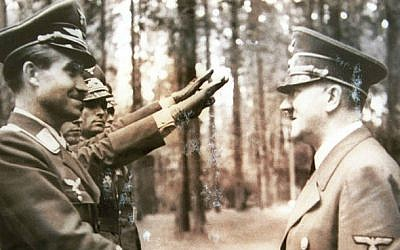 Reproduction of a photograph of Adolf Hitler receiving the Nazi salute from Israel Nazi hunter Tovia Fridman archive. (photo credit: Roni Schutzer/Flash90)