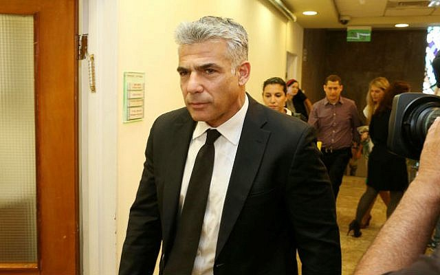 Finance Minister Yair Lapid arrives at the Prime Minister's Office in Jerusalem, April 27, 2014 (photo credit: Amit Shabi/POOL/Flash90)