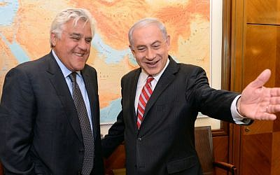 Prime Minister Benjamin Netanyahu (R) meets with American comedian Jay Leno, at the Prime Minister's Office in Jerusalem on May 21, 2014. (photo credit: Kobi Gideon/ GPO/FLASH90)