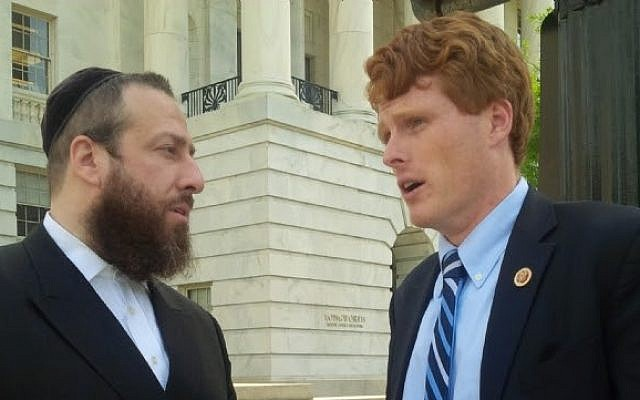 Lobbyist Ezra Friedlander, left, in discussion with Representative Joseph P. Kennedy III after the passing of the legislation.(photo credit: Courtesy)