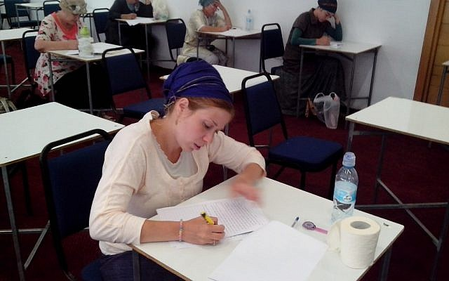 Illustrative: Miriam Goldfisher, director of a kosher supervision class for women, studying Jewish dietary laws in preparation for the Israeli Chief Rabbinate exam on the topic. (JTA)