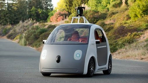 This image provided by Google shows a very early version of Google's prototype self-driving car. The two-seater won't be sold publicly, but Google on Tuesday, May 27, 2014 said it hopes by this time next year, 100 prototypes will be on public roads. (photo credit: AP Photo/Google)