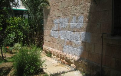 Anti-Christian graffiti covered up at the Rumanian Orthodox Church in Jerusalem, May 9, 2014. (Photo credit: Ilan Ben Zion/Times of Israel staff)