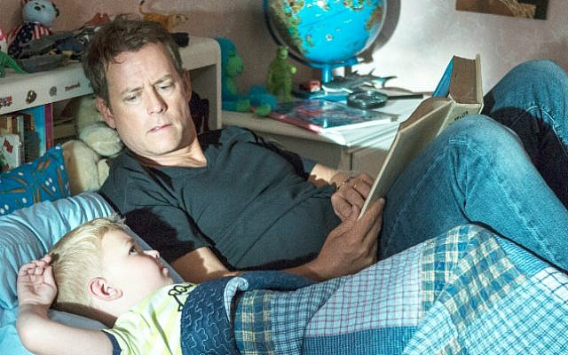 Greg Kinnear listens to, or perhaps coaches, his son in 'Heaven Is For Real.' (courtesy: Sony/Tristar Pictures)