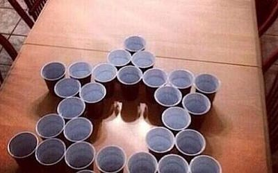 Screenshot from a report on Fox4 in Florida displaying a picture of the Jews vs Nazis beer pong drinking game tweeted by high school kids.
