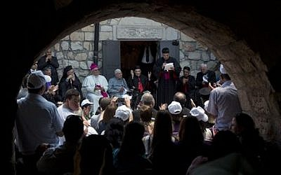 Cardinal Beshara Rai, the head of Lebanon's Maronite Catholics, gathers with other clergy and supporters next to a church in the ruins of the village of Kufr Birim, northern Israel, Wednesday, May 28, 2014. It was one of two politically charged visits to disparate Maronite flocks in Israel Wednesday in a precedent-setting Holy Land pilgrimage overshadowed by criticism back home. (photo credit: AP Photo/Sebastian Scheiner)