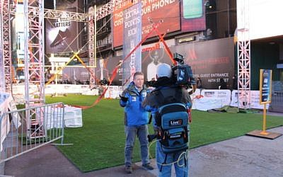 A reporter broadcasts a live TV interview 'in the field' using LiveU equipment (Photo credit: Courtesy)