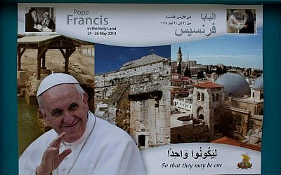 A welcome poster with a picture of Pope Francis posted on a street near the Church of the Nativity, in the West Bank city of Bethlehem, May 12, 2014 . (AP/Nasser Nasser)
