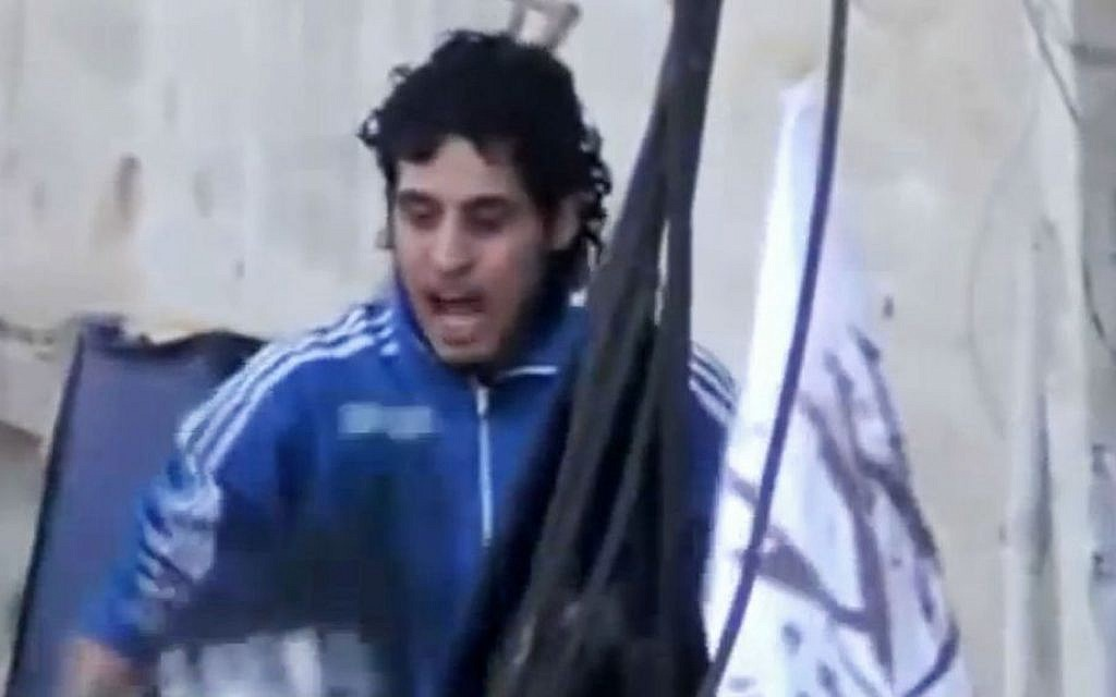 Amateur video image showing revolutionary goalkeeper Abdelbasit Sarout chanting slogans during a demonstration in Homs, Syria,Feb. 13, 2014.  (AP/Shaam News Network via AP video)