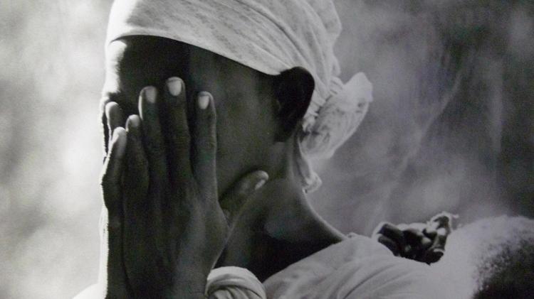Mozambican refugee at Sunday mass, Lundo installation area, Tanzania, 1968 © UNHCR J. Mohr.