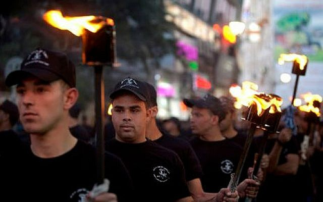"Palestinians hold torches marking the 66th anniversary of ""Nakba,"" or ""catastrophe"" referring to their uprooting in the war over Israel's 1948 creation, in the West Bank city of Ramallah, Wednesday, May 14, 2014 (photo credit: AP/Majdi Mohammed)"