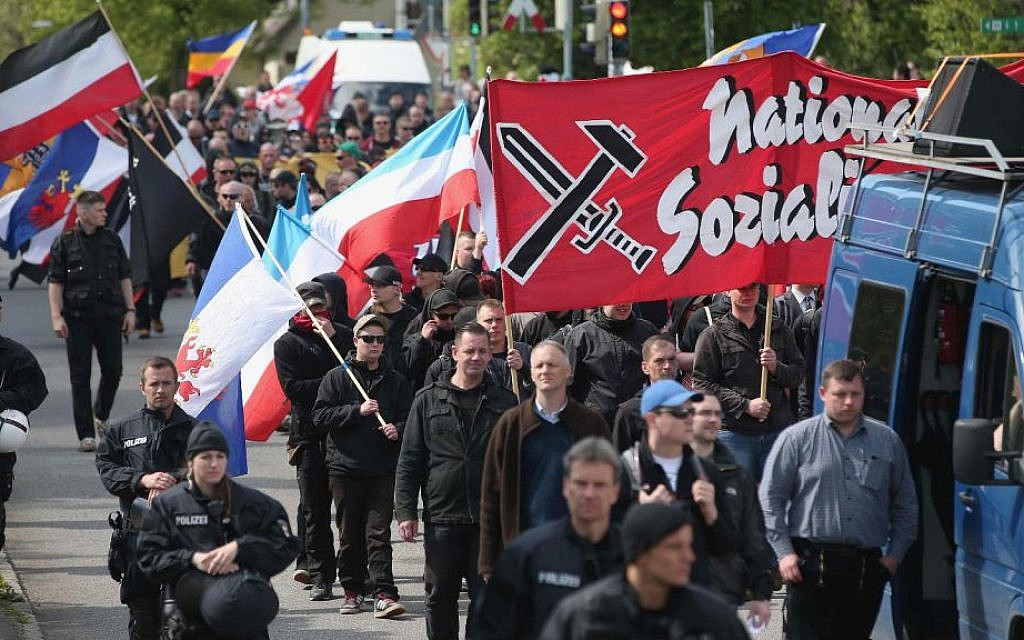 Some 250 supporters of the far-right National Democratic Party marching on May Day in Rostock, Germany, are accompanied by riot police, May 1, 2014. (Sean Gallup/Getty Images/via JTA)
