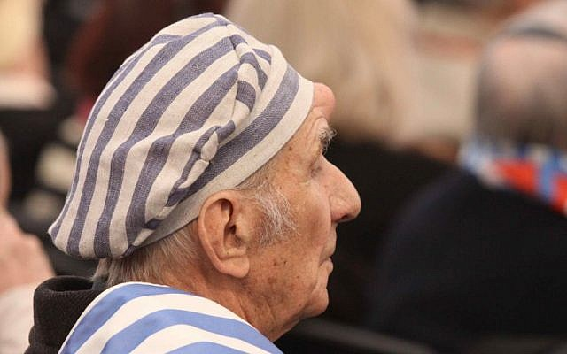A Holocaust survivor seen during a ceremony at the former Auschwitz-Birkenau concentration and extermination camp in Poland. (photo credit: Isaac Harari/Flash90)