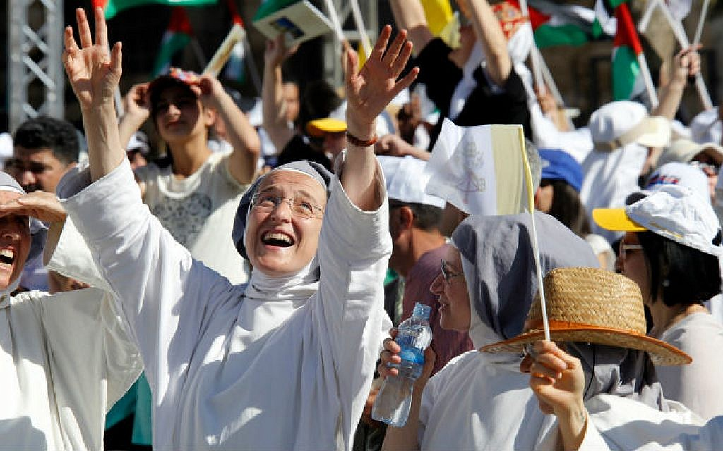Christian nuns cheers as they wait for Pope Francis (not pictured) leading an open-air mass in Manger Square, next the Nativity Church, in the West Bank city of Bethlehem on May 25, 2014 (photo credit: Sliman Khader/Flash90)