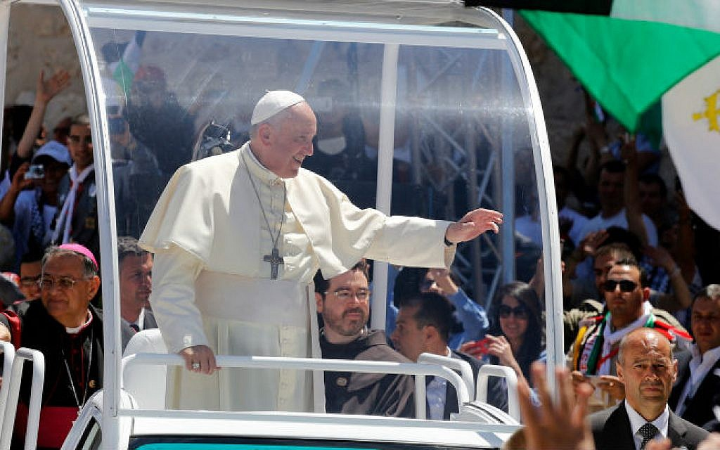 Pope Francis waving to the people after a mass in the Manger Square, next the Nativity Church, in the West Bank city of Bethlehem on May 25, 2014 (photo credit: Sliman Khader/Flash90)