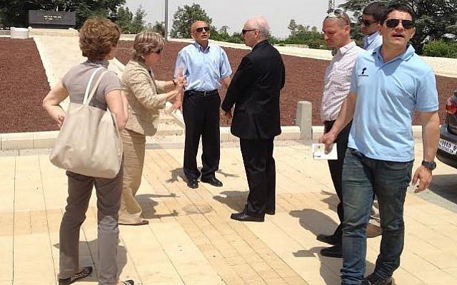 Archbishop Guiseppe Lazzarotto, the Holy See's chief diplomatic envoy to Israel, with Israeli Foreign Ministry  staff at Theodor Herzl's grave on Mount Herzl, Wednesday, May 21, preparing for the pope's visit to the site. (photo credit: ToI staff)