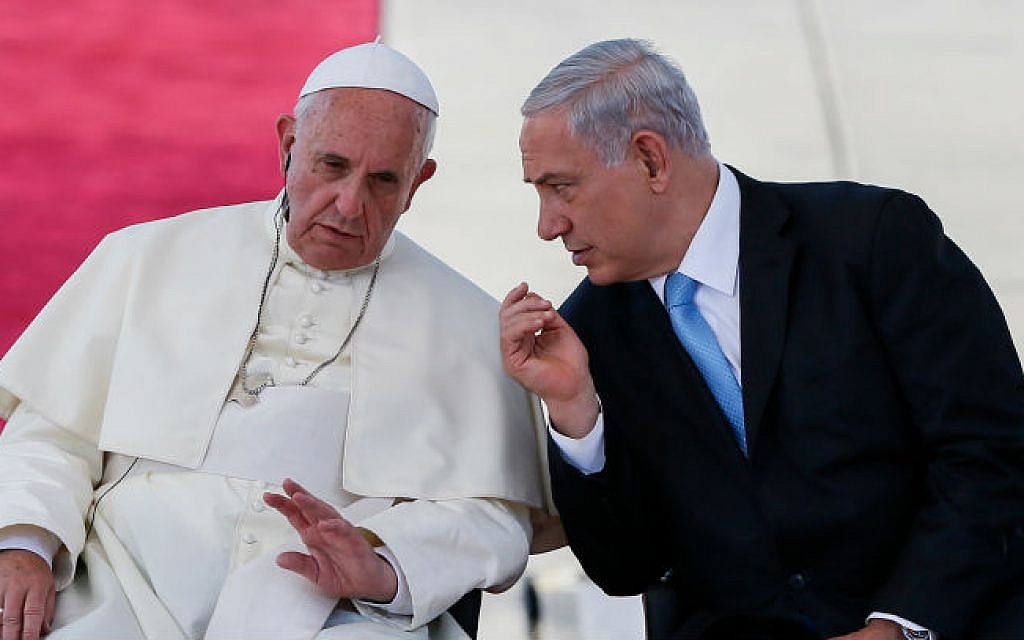 Israel's Prime Minister Benjamin Netanyahu seen with Pope Francis at a welcoming ceremony, as the pope lands at Ben Gurion international airport, near Tel Aviv, May 25, 2014 (photo credit: Miriam Alster/Flash90)