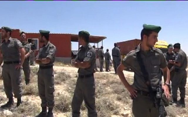 Border Police outside a home slated for destruction in Ma'ale Rehavam Wednesday. (Screen capture: Israel National News)