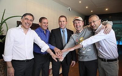 (L to R) Ze'ev Goldberg, chairman of Unlimited; Yiftach Ron-Tal, IEC chairman; Communications Minister Gilad Erdan; Jonas Birgeson, chairman of ViaEuropa Israel; and Dov Lauver, Unlimited CEO at Tuesday's announcement event (Photo credit: Gideon Markovitch)