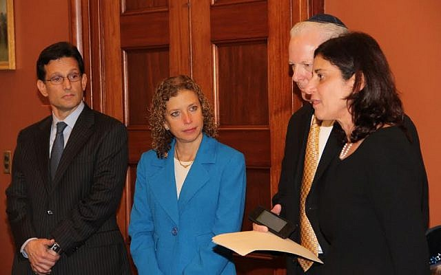 A meeting May 1 at the office of US House of Representatives Majority Leader Eric Cantor.  Cantor (left) and Rep. Debbie Wasserman Schultz (second left), the Republican and Democratic leaders, listen as Sheryl and Tuly Wultz talk about the impact of prayer and faith in their ongoing fight for justice for their son, Daniel Wultz. (photo credit: Courtesy)