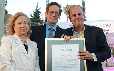 Dr. Micah Goodman (far right) accepts the Schechter Institute's 2014 Marc and Henia Liebhaber Prize for Religious Tolerance from MK Colette Avital and Prof. David Golinkin. (courtesy)