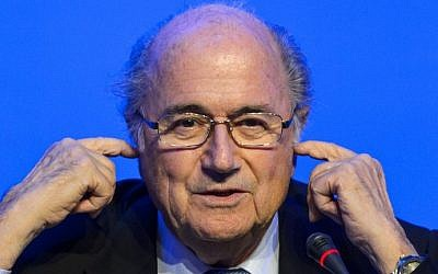 FIFA president Joseph Blatter gestures during a press conference closing the 64th FIFA congress on June 11, 2014 in Sao Paulo, on the eve of the opening match of the 2014 FIFA World Cup in Brazil. photo credit: AFP/FABRICE COFFRINI)