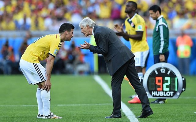 Colombia's Argentinian coach Jose Pekerman (R) talks to midfielder James Rodriguez (L) during a Group C football match between Colombia and Greece at the Mineirao Arena in Belo Horizonte during the 2014 FIFA World Cup on Saturday, June 14, 2014 (photo credit: AFP/EITAN ABRAMOVICH)