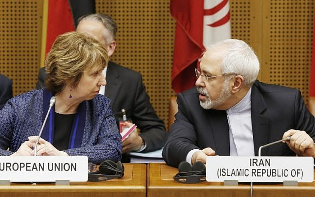 Vice President of the European Commission Catherine Margaret Ashton (L) and Iranian Foreign Minister Mohammad Javad Zarif attend the so called EU 5+1 Talks with Iran at the UN headquarters in Vienna, on June 17, 2014. (photo credit: AFP/Dieter Nagl)