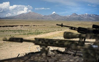 A general view of rifles on a range at a Forward Operating Base in Afghanistan on May 28, 2014  (photo credit: AFP/Brendan Smialowski)