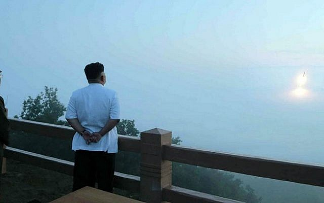 This undated picture released from North Korea's official Korean Central News Agency on June 30, 2014 shows North Korean leader Kim Jong-Un observing a tactical rocket launch by the Korean People's Army Strategic Force at an undisclosed place in North Korea. (AFP/KCNA via KNS)