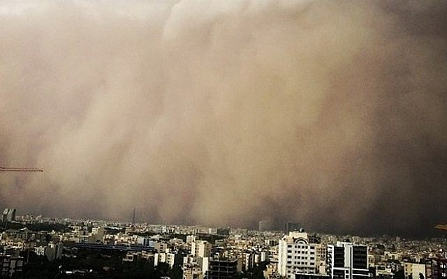 A picture taken with a smartphone shows a sandstorm engulfing the Iranian capital Tehran on June 02, 2014. (photo credit: AFP PHOTO/STR)