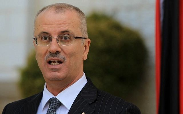 Palestinian Authority Prime Minister Rami Hamdallah speaks during a press conference following the first cabinet meeting of the new Palestinian unity government in the West Bank city of Ramallah on June 3, 2014. (photo credit: Abbas Momani/AFP)