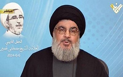Hezbollah's al-Manar TV shows Hezbollah chief Hassan Nasrallah giving a televised address from an undisclosed location on June 6, 2014 (Photo credit: Al-Manar/AFP)