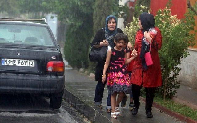 Iranians on the streets of Tehran, illustrative photo (Photo credit: Atta Kenare/AFP)