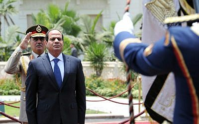 President-elect Abdel Fattah al-Sisi reviewing the honor guard during the handing over of power ceremony in Cairo,  June 8, 2014. (photo credit: AFP/ Egyptian Presidency)