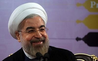 Iranian President Hassan Rouhani speaks during a press conference in the capital Tehran on June 14, 2014. (photo credit: AFP Photo/Atta Kenare)