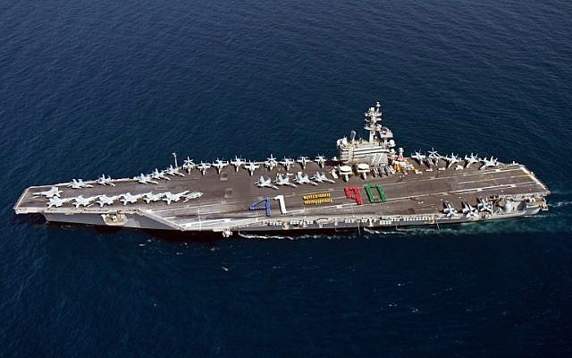 A handout picture released by the US Navy shows aircraft carrier USS George H.W. Bush (CVN 77) sailing in the Arabian Sea on June 13, 2014. (photo credit: AFP PHOTO / HO / US NAVY)