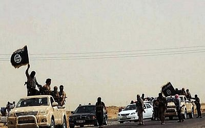 An image allegedly showing militants of the Islamic State of Iraq and the Levant (IS) driving on a street at unknown location in the Salaheddin province, Iraq,  2014. (photo credit: AFP / HO / WELAYAT SALAHUDDIN)