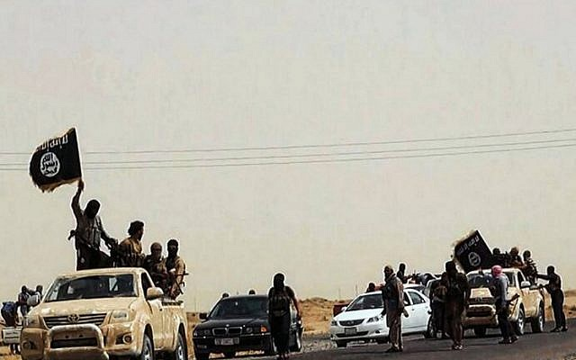 An image allegedly showing militants of the Islamic State of Iraq and the Levant (ISIL) driving on a street at unknown location in the Salaheddin province, Iraq,  2014. (photo credit: AFP / HO / WELAYAT SALAHUDDIN)