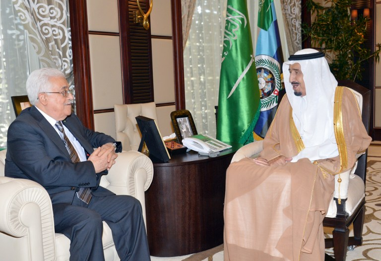 Saudi Arabia's then Crown Prince Salman bin Abdulaziz al-Saud (right) meeting with Palestinian Authority President Mahmoud Abbas (left) in the Saudi Red Sea resort of Jeddah, on June 18, 2014. (AFP/HO/Saudi Press Agency)
